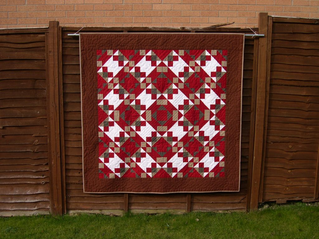 Red brown and white patchwork quilt
