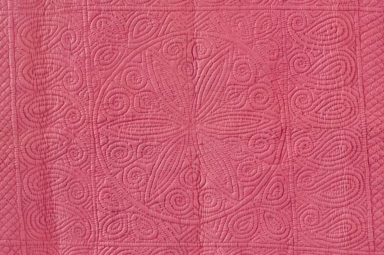 Deep pink wholecloth quilt
