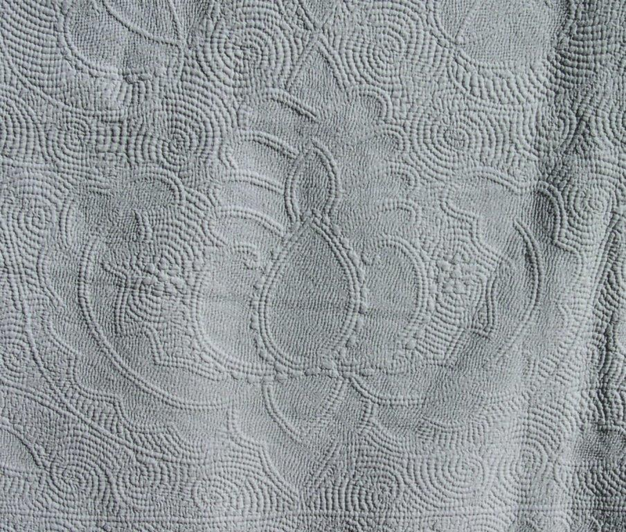 Pineapple motif stitched in white on white