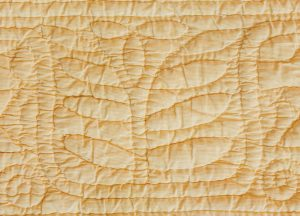 Hand-quilted leaf motif