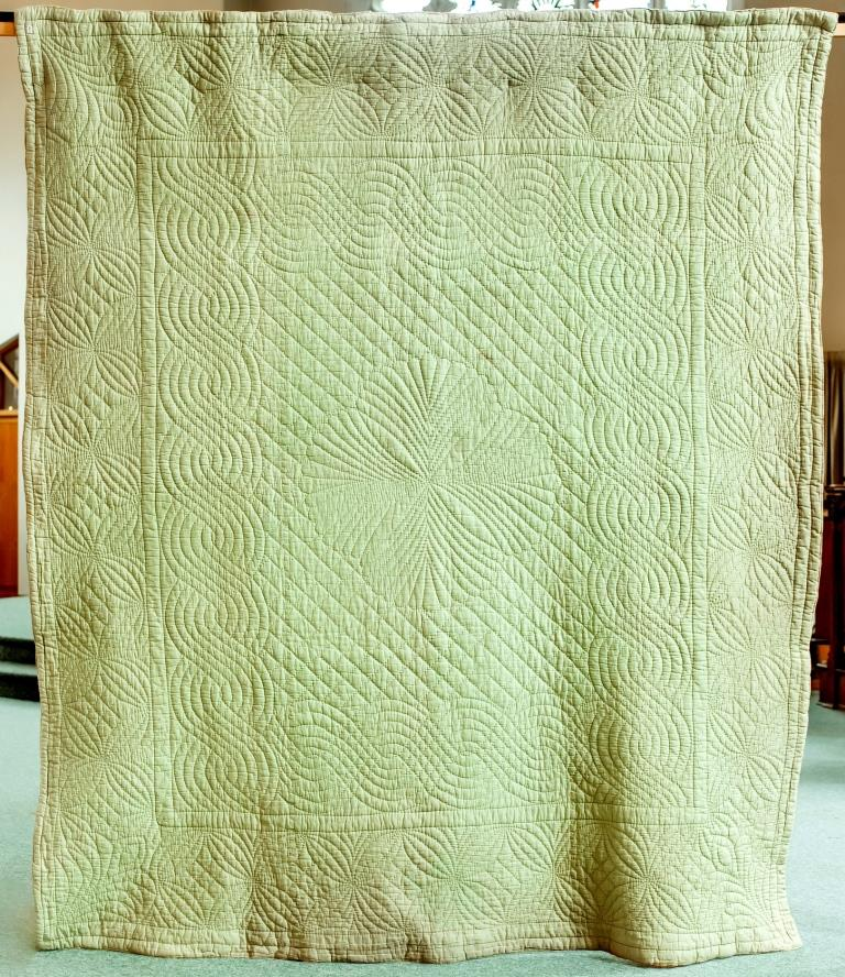 Green hand-quilted antique