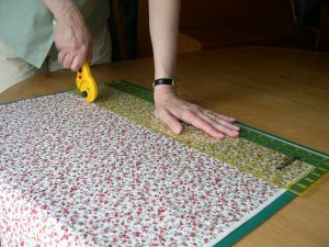 Cutting fabric using a rotary cutter