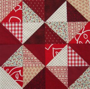 Scrappy red and white star block