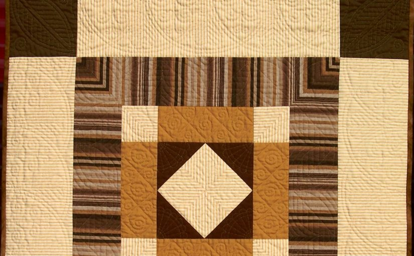 Brown and cream quilt with Welsh hand quilting motifs
