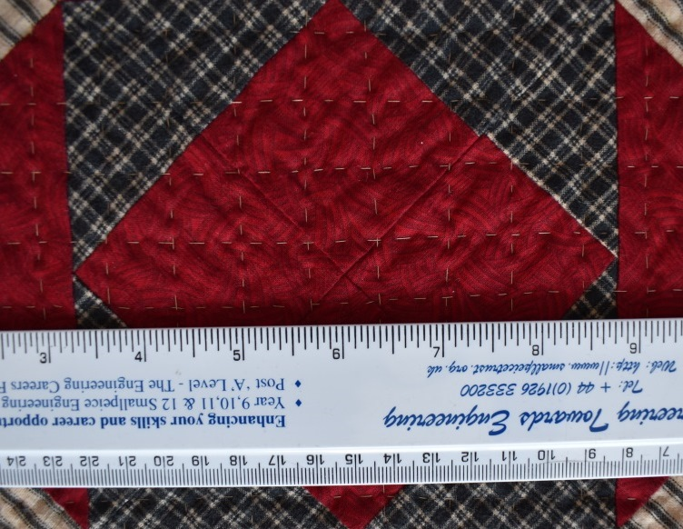 Large hand-quilted stitches