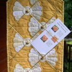 Yellow and white hanging made to display cards