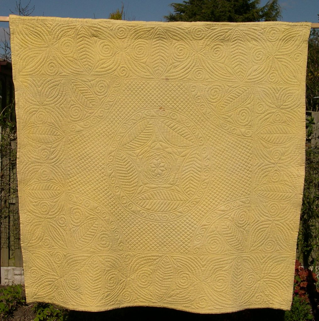 Antique welsh wholecloth quilt in pale yellow