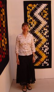 Carolyn with her quilt named Thunderstorm