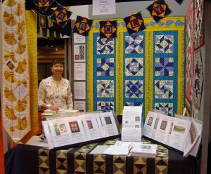 Carolyn Gibbs stand at the Festival of Quilts