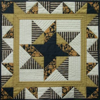 Black and gold patchwork quilt