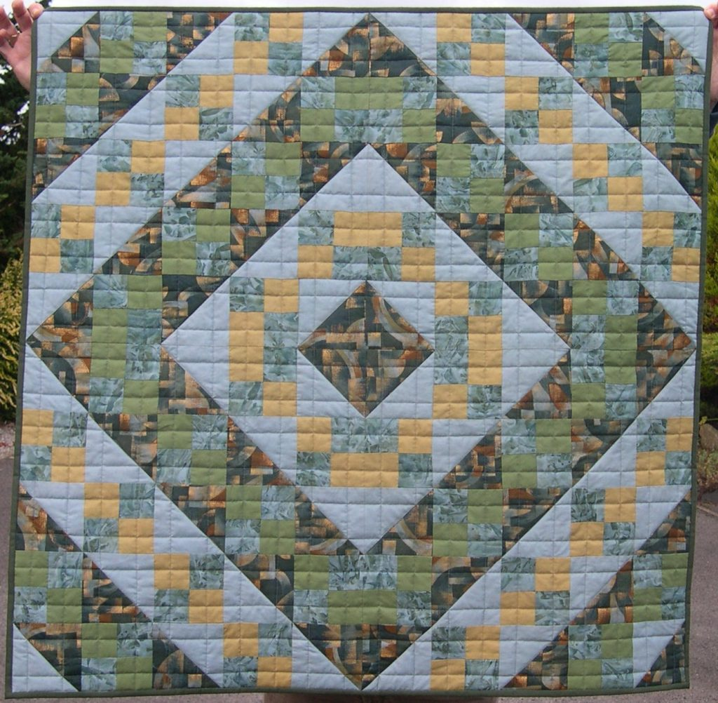 Muted green and apricot quilt