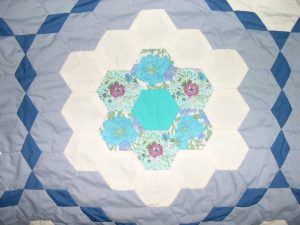 Vintage quilt made of Blue and white pieced hexagons