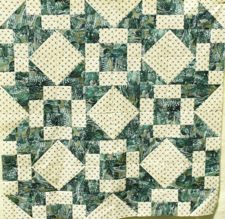 Green and cream quilt