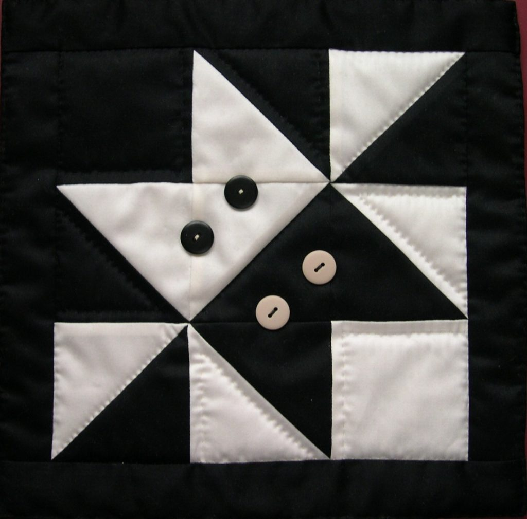 Patchwork showing two stylised cats