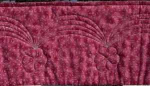 Quilted border design of swags with pansies