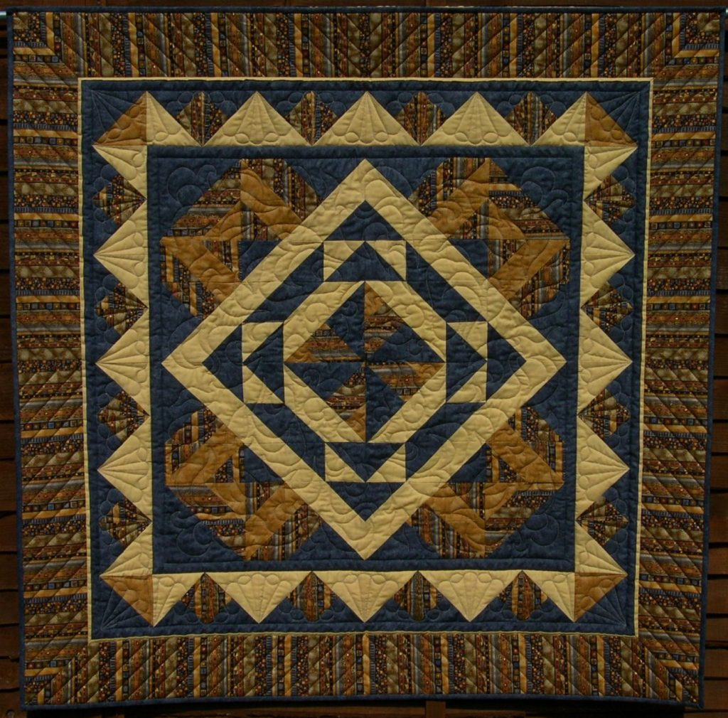 Gold, brown and pewter patchwork design