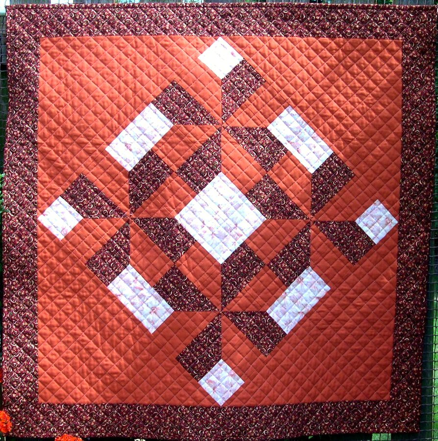 Terracotta, cream and mulberry patchwork
