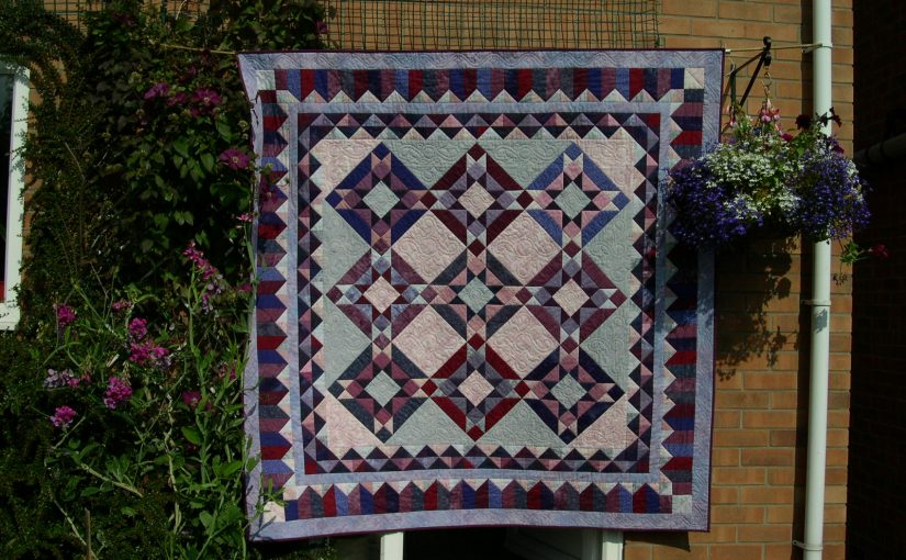 Large bed patchwork quilt in pink & purple