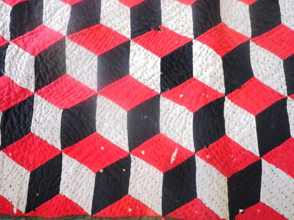 Red, grey and black tessellating diamonds