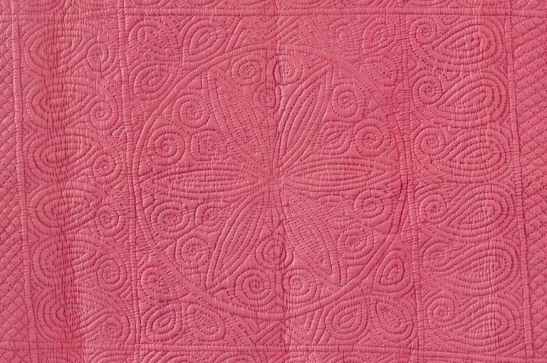 Deep pink wholecloth quilt