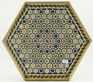 Hexagonal framed piece of silk ribbon patchwork