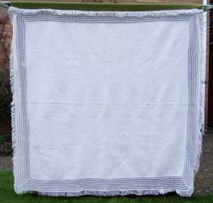White tablecover with fringe