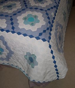 Blue diamonds down corner of quilt