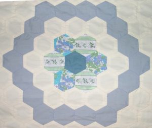 Blue and white hexagons arranged in a circular pattern