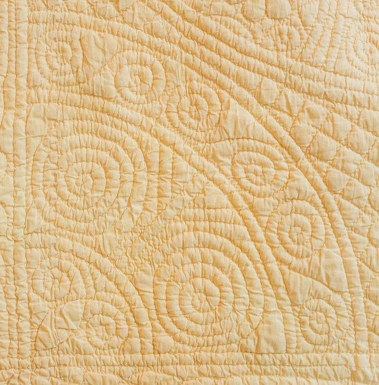 Quilted fan motif made of spirals