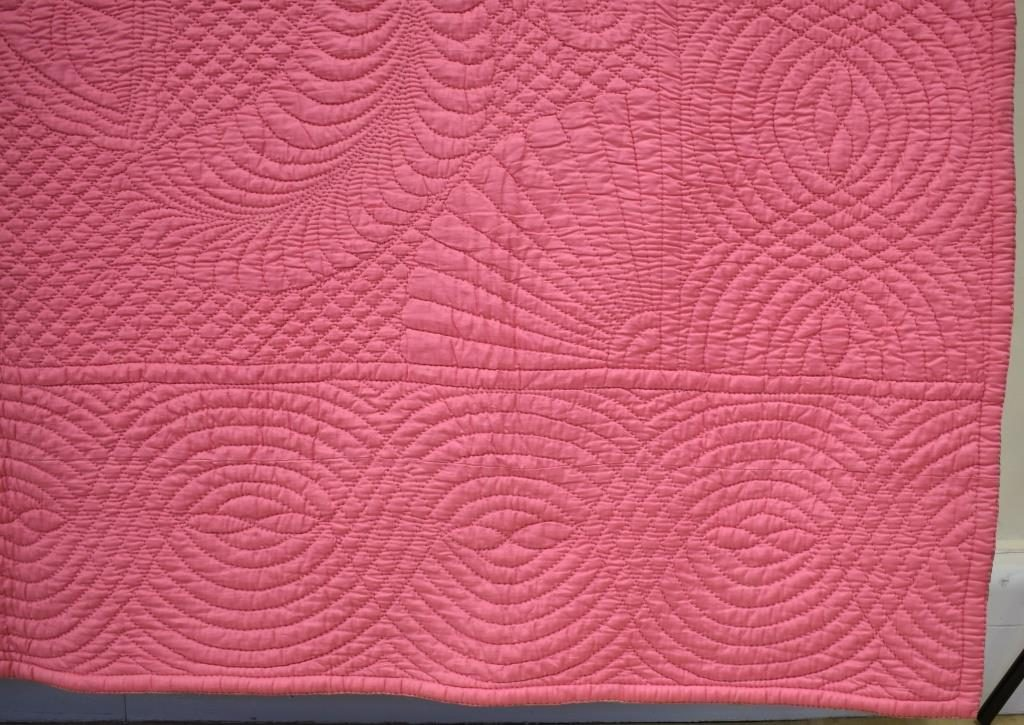 Pink quilt with broad cable
