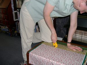 Ruler, mat and fabric on low table