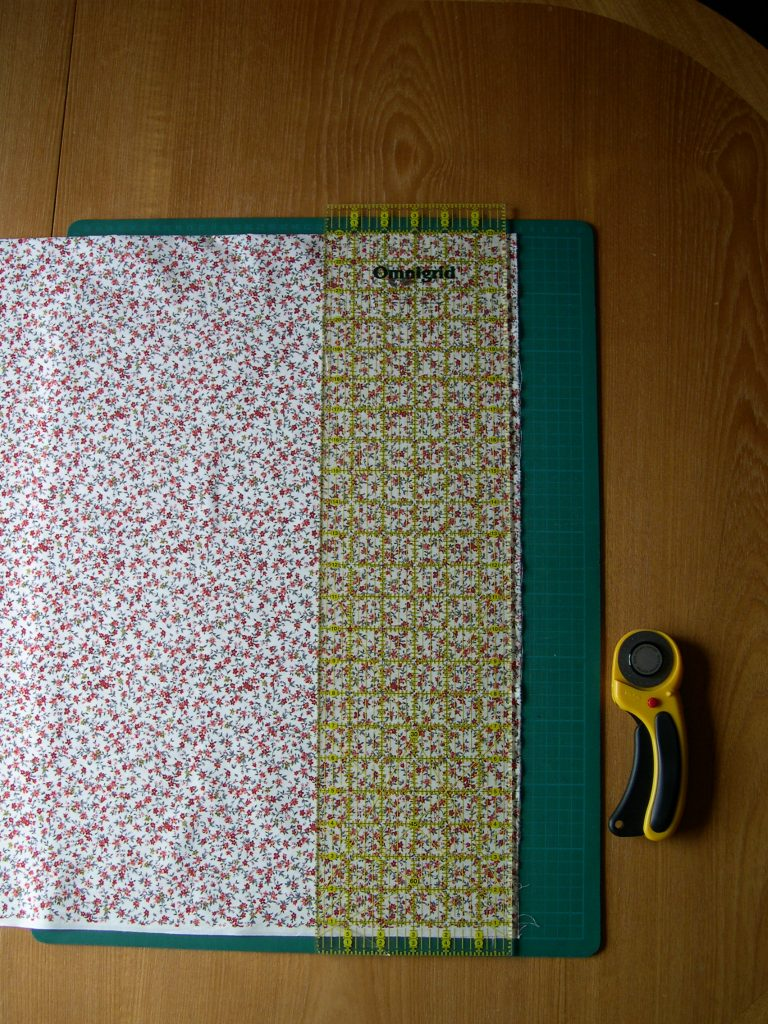 Fabric on cutting mat with quilters ruler