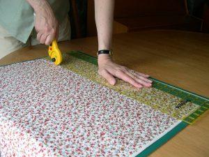 Cutting fabric using a rotary cutter