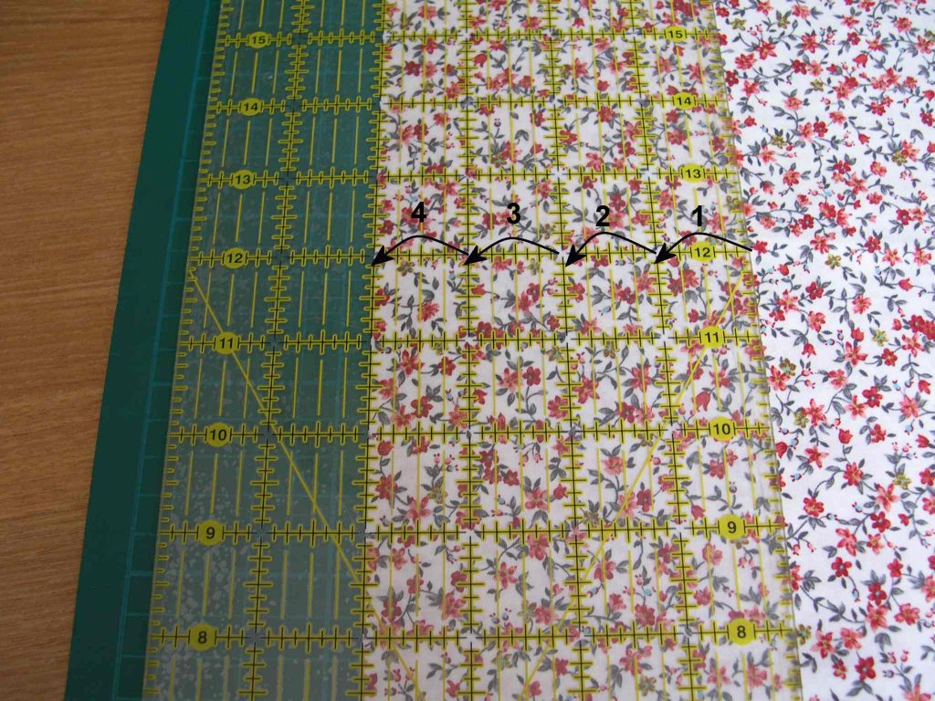 "Ruler arranged with 4"" of fabric underneath"