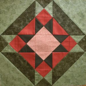 Soft green and terracotta patchwork star block
