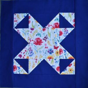 Flowery star on bright blue background