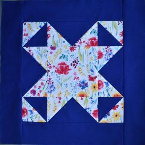 Flowery star on bright blue background