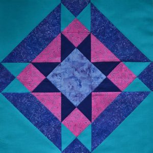 Blue, pink & turquoise star patchwork block