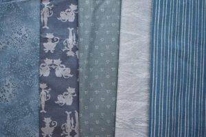 Different colours of pale blue-green fabrics