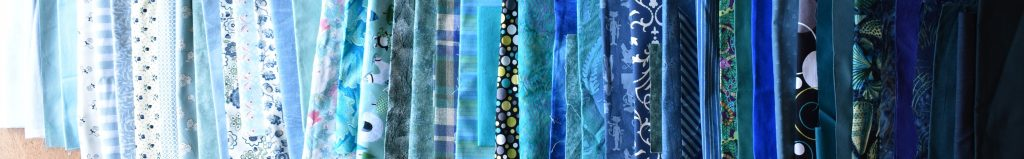 Blue-green fabrics arranged in order of value