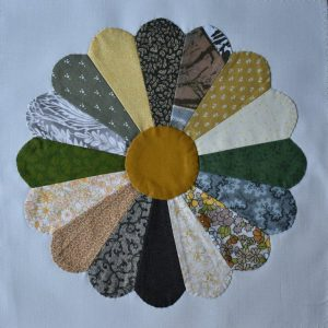 Circular patchwork design made up of yellow and green petals