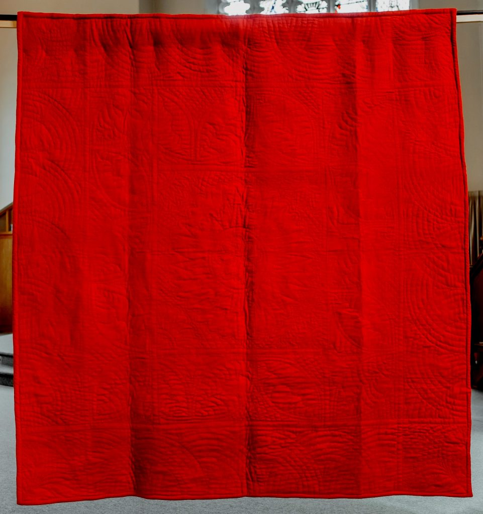 Bright red woollen quilt