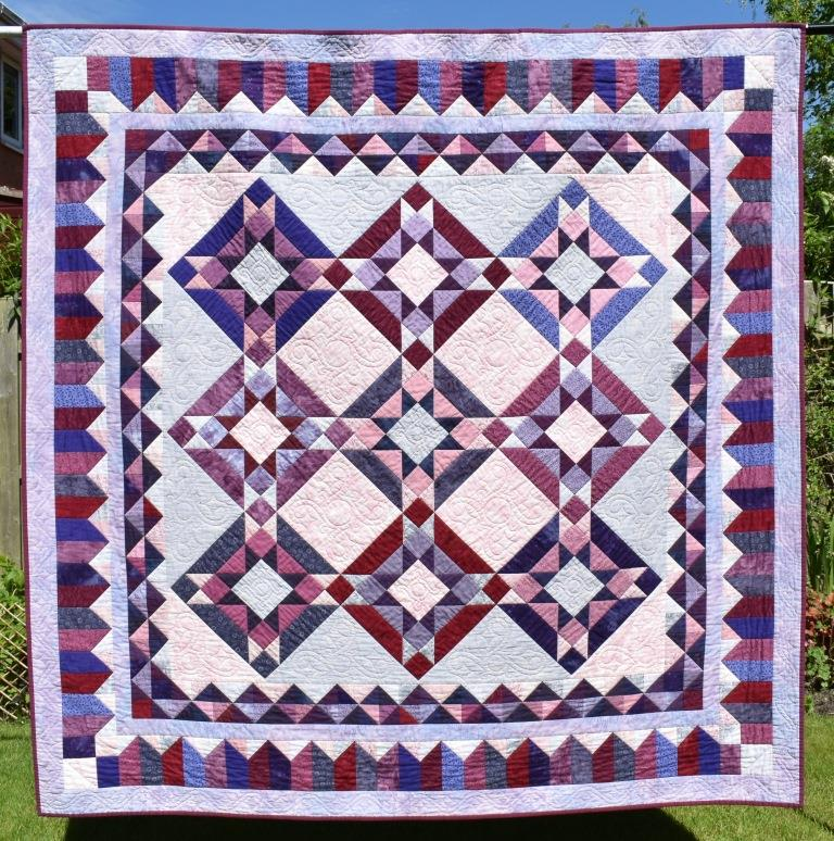 Pink & purple patchwork quilt