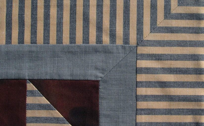 Striped fabrics meet perfectly in border corner