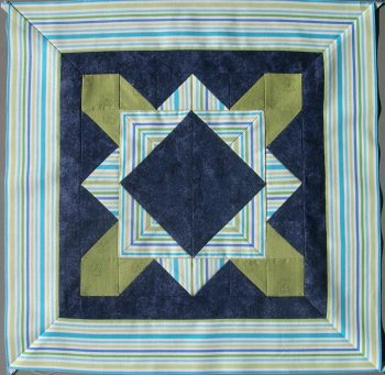 Blue, lime green and tut=rquoise block with striped border