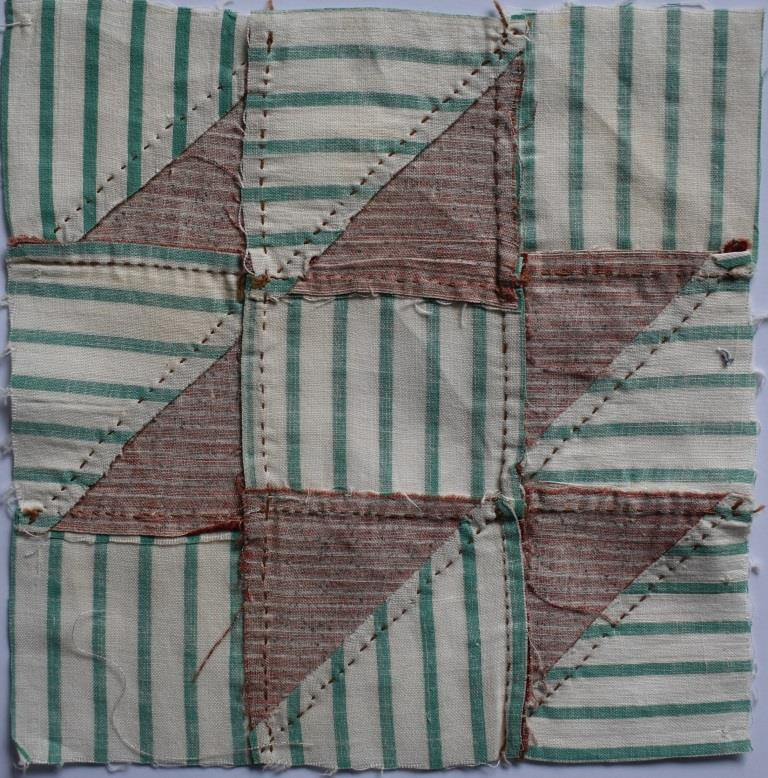 Hand-stitched red and green patchwork block