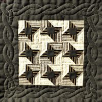 Small quilt with brown and cream stars and cable borderstars