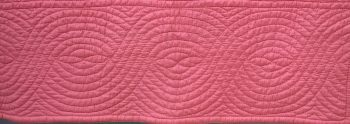 Pink quilt border with cable design
