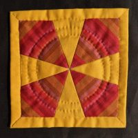 Red and yellow patchwork mat