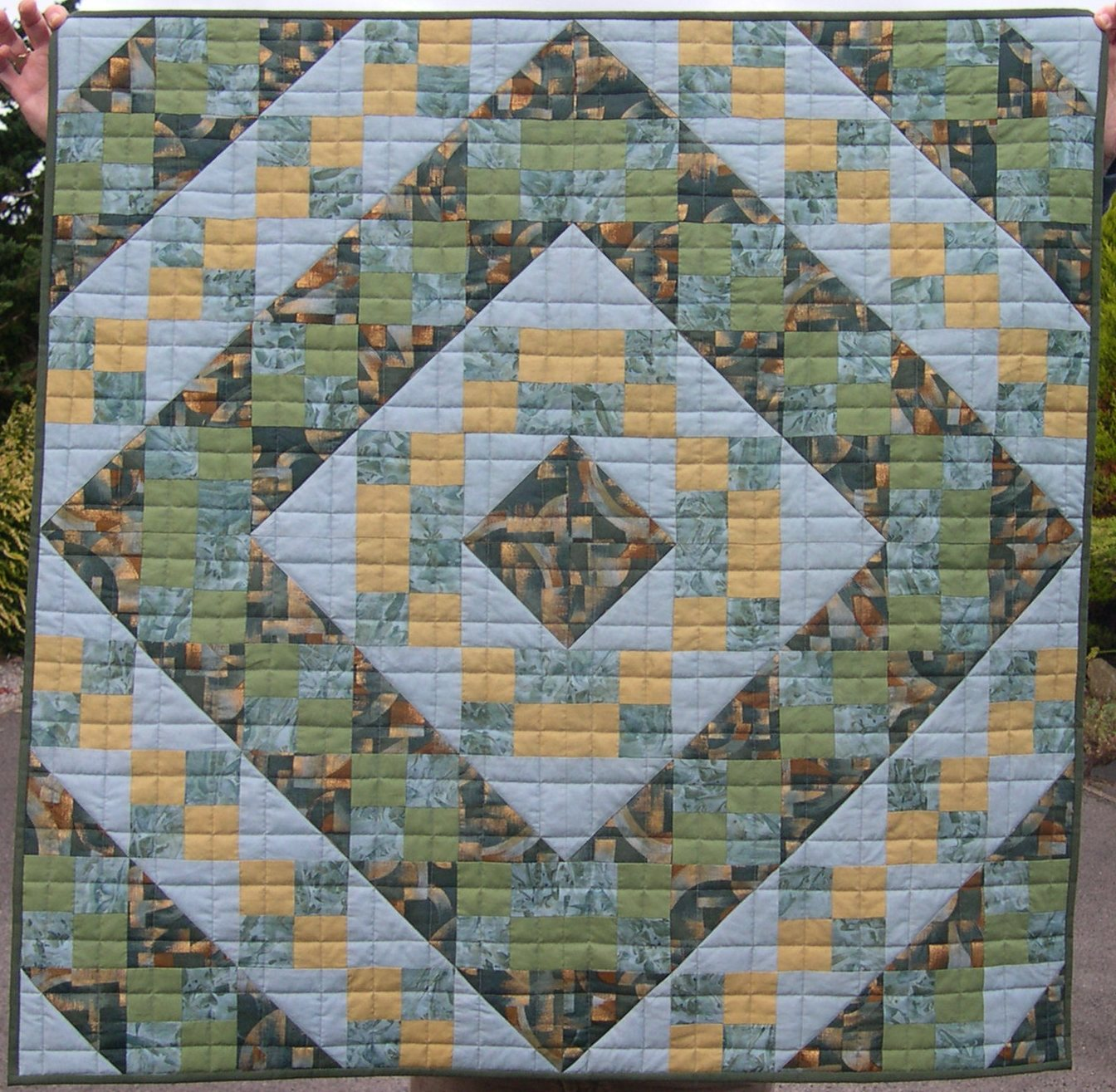 Blue and green patchwork with straight grid